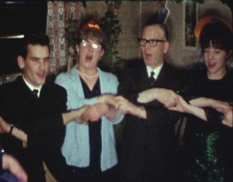 1965 image of people singing at a New Year's Eve Party